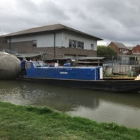 Exbury Egg towed by C&RT barge along Grand Union Canal